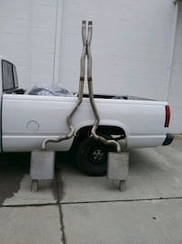 Muffler with tail pipe