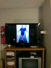 flat screen television with brown wooden TV stand San Antonio, 78220