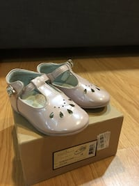 Pair of light pink/blush leather flats