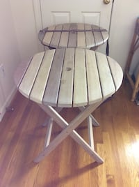 Two round white or white wash sturdy wooden patio tables used mostly indoors and always stored indoors Georgetown, 01833