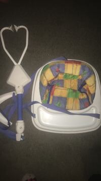baby's white and blue hanging jumperoo