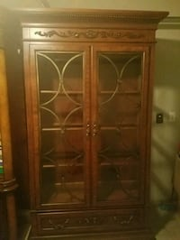brown wooden framed glass display cabinet Missouri City, 77459