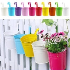 assorted color tin fence mounted plant pots