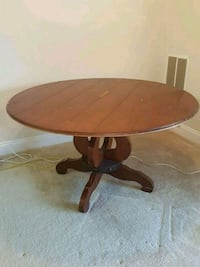 Round brown wooden pedestal table Beltsville, 20705