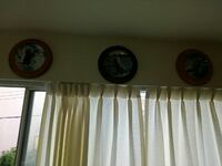 three round animals paint ceramic decorative plates and two white grommet window curtains