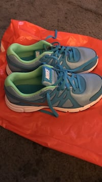 Pair of gray-and-teal nike running shoes Las Vegas, 89102