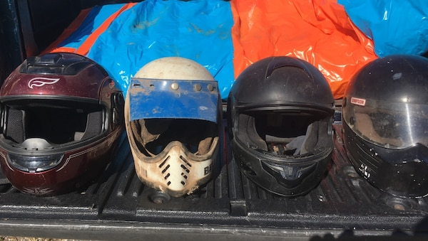 Four assorted colors of full-faced motorcycle helmets