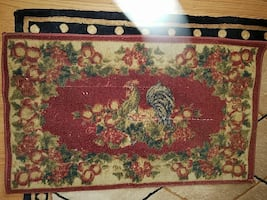 red and brown floral area rug