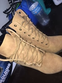 pair of women's brown suede lace-up boots