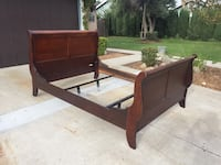 brown wooden bed frame with mattress 2232 mi