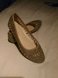 pair of gold glittery flats Houston, 77076