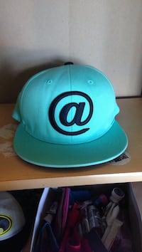 Teal and black fitted cap