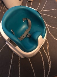 blue and white Bumbo floor seat Burnaby, V5G 3J1