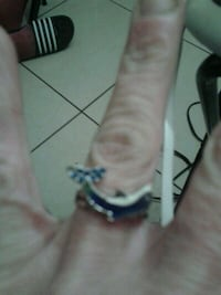 Adjustable dolphin ring with blue diamonds on tail 1003 mi