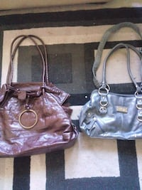 two black and purple leather tote bags Medicine Hat, T1A 7M1