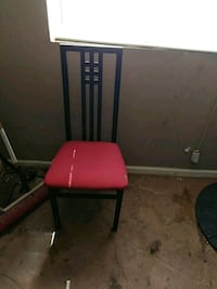 red and black rolling chair 1957 mi