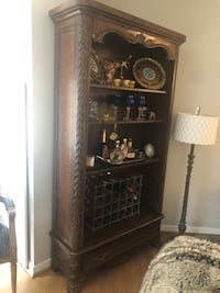 Walnut book case. Gorgeous carvings and detail. Leather sides. Very solid piece in excellent condition Philadelphia, 19103