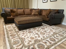 Super comfortable down sectional for sale. Faux Leather, Down pillows.