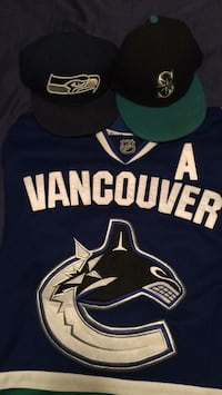 official canucks jersey and seahawks/mariners hats. good condition. Abbotsford, V2T