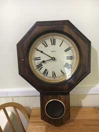 brown wooden framed analog clock Germantown, 20874