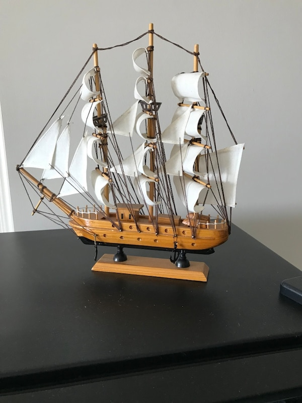 Brown and white galleon ship scale model