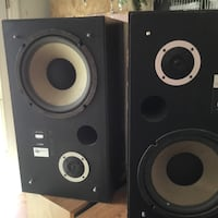 pair of rectangular black audio speakers