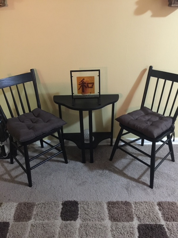 three black wooden armless chairs
