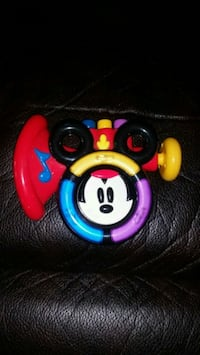 Disney blue, red, and yellow plastic Mickey Mouse