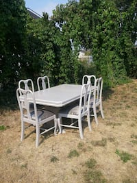 rectangular white wooden table with six chairs dining set Kelowna, V1X 2K6