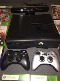 Black Xbox 360 console with controllers