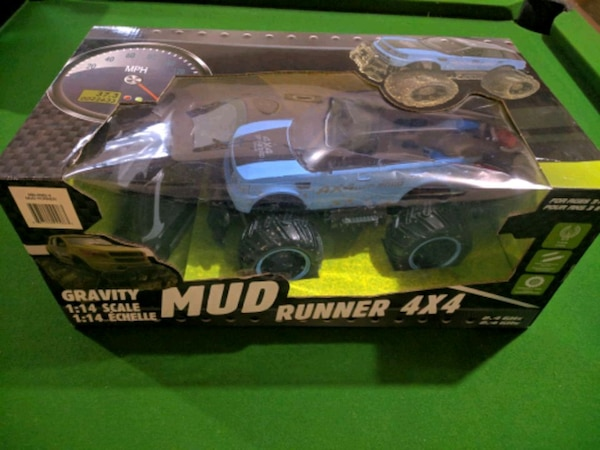 black and blue RC car toy in box