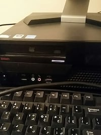 black DVD player with corded computer keyboard Calgary, T1Y 1V3