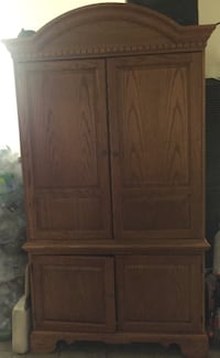 brown wooden four-door entertainment center , good condition practically new