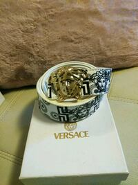 Silver and black versace buckle with black leather belt