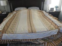 A set of queen size bedding with bedsheet, 2 Shams and matching bedcover