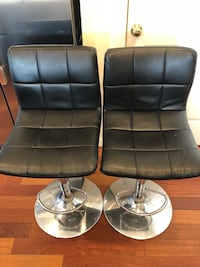 two black leather padded rolling chairs Ashburn, 20147