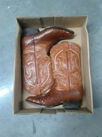 pair of rust leather and snake skin cowboy boots in box