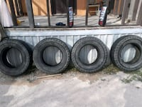 four black vehicle tires with wheels Odessa, 79763