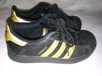 Black and gold ADIDAS Superstars. St. Catharines, L2T 2K9
