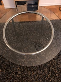 Round black metal framed glass top table Washington, 20036