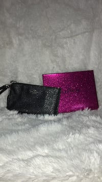 black and pink leather wallet 150 mi