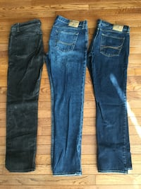 two blue and one black jeans