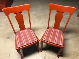 Red antique lacquered chairs with old patina, but new fabric.
