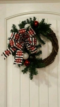 Christmas wreath with black and white ribbon with ornaments