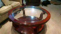 round brown wooden framed glass-top coffee table 471 km