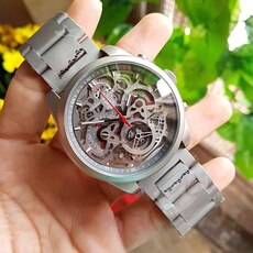 round gray mechanical watch with gray link