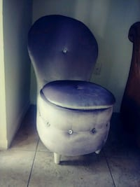 grey chair with a secret cover.  Coconut Creek