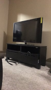 black flat screen TV with black wooden TV stand Charlotte, 28262