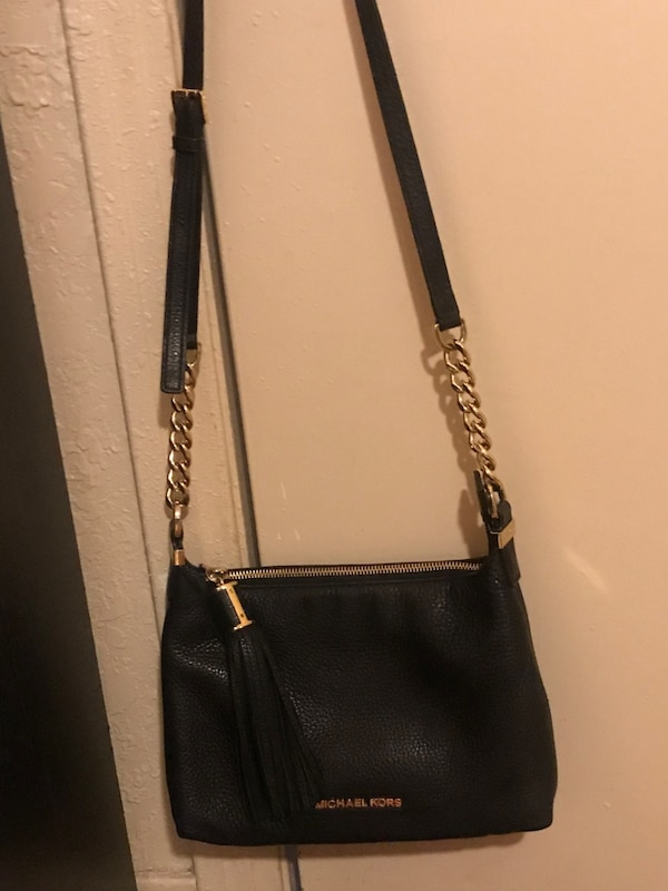 Women's black mk leather sling bag