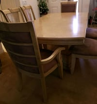 rectangular wooden table with six chairs din